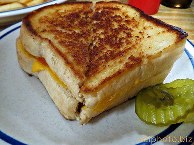 """Don's grilled cheese voted best in stateBy kukur on Nov 15, 2013 at 4:24pmhttp://www.morrissuntribune.com/content/dons-grilled-cheese-voted-best-stateMORRIS – When you've got something good in your community, it's easy to forget it's there.That might be the case with the grilled cheese sandwich at Don's Cafe in Morris.Since the sandwich was voted """"Best of Minnesota"""" as part of WCCO's Viewers' Choice awards last week, sales of the grilled cheese sandwich have tripled, said owner Marsha Buss.""""We've had people who hadn't been here for awhile, either forgot what it tastes like to weren't prone to ordering it that I think have decided to come in and try it,"""" said Buss.""""It's gotten a little busier,"""" concurred Marsha's son, Michael.Marsha said she learned about the voting last Monday morning, but didn't think anything of it until WCCO's Matt Brickman gave her a call on Tuesday afternoon. By that time, Don's was so far ahead in the viewer poll the restaurant was the clear winner.Brickman and a cameraman arrived in Morris on Thursday around lunch time to talk with patrons and learn the secret of Don's famous grilled cheese.Marsha said the secret to the sandwich is the restaurant's grill, which has been used to cook everything from bacon to burgers to grilled cheese for the last 30 years.Michael said the secret is the bread. Marsha and her husband, Greg, bought the recipe for Don's bread – a key ingredient in the grilled cheese sandwich – when they purchased the restaurant 14 years ago. Greg arrives at Don's every morning at about 3:15 a.m. to make the 24 fresh loaves of bread each day.Since demand for the grilled cheese has been up, Greg has sometimes had to come in during the afternoon to make a few extra loaves of bread.""""It's a sandwich that's been made the same way ever since we bought the place, and it was done that way before,"""" said Marsha. One recent change is an additional slice of American cheese. Patrons also make their own customizations, adding tomato or bacon or """